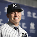 Jacoby Ellsbury smiles while taking questions during a news conference at Yankee Stadium, Friday, Dec. 13, 2013, in New York. The former Boston Red Sox outfielder agreed to a $153 million, seven-year contract with the Yankees. (AP Photo/John Minchillo)