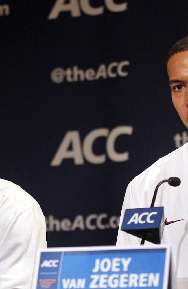 Virginia Tech basketball players Ben Emelogu, left, and Joey van Zegeren answer questions at a press conference during the NCAA college basketball Atlantic Coast Conference media day in Charlotte, N.C., Wednesday, Oct. 16, 2013