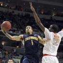 California guard Justin Cobbs (1) drives to the basket against Syracuse center Baye Keita (12) during the second half of a third-round game in the NCAA college basketball tournament Saturday, March 23, 2013, in San Jose, Calif. Syracuse won 66-60. (AP Photo/Tony Avelar)