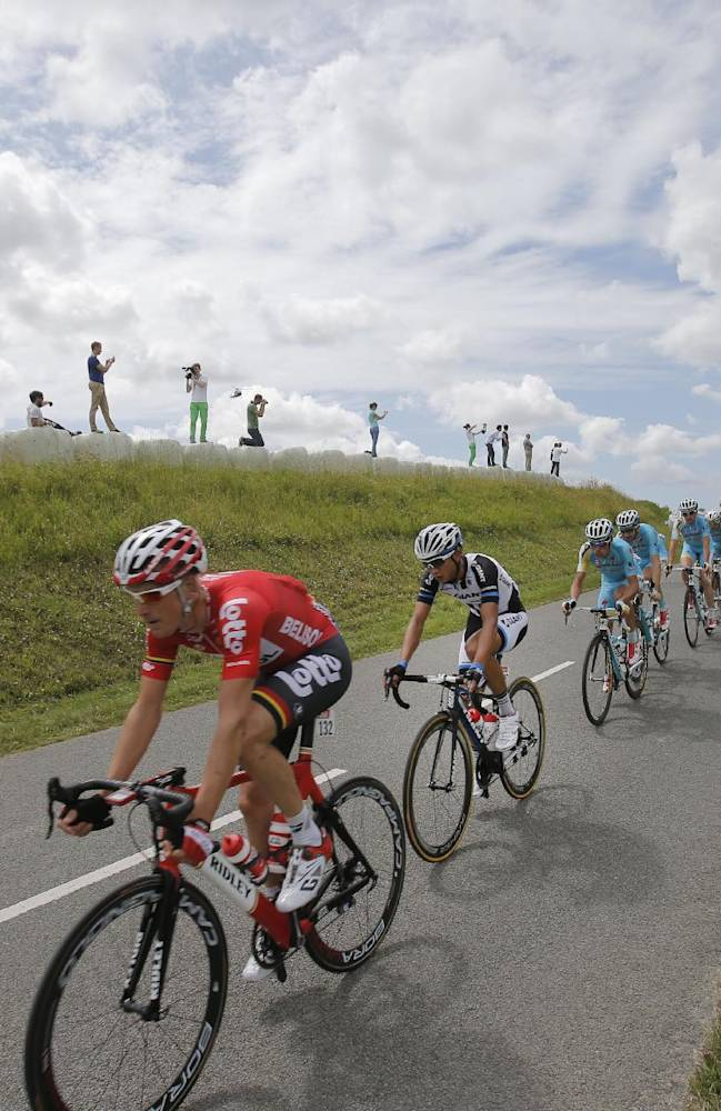 China's Cheng Ji, in second position, the first Chinese rider to participate in the Tour de France, follows Denmark's Lars Ytting Bak, left, as they ride in the pack during the fourth stage of the Tour de France cycling race over 163.5 kilometers (101.6 miles) with start in Le Touquet and finish in Lille, France, Tuesday, July 8, 2014