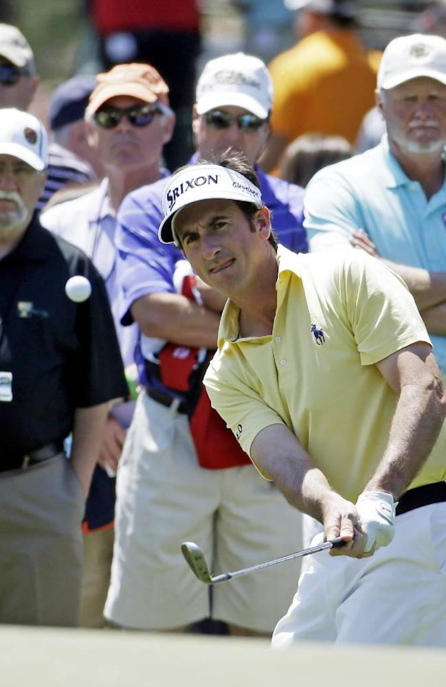 Gonzalo Fernandez-Castano, of Spain, chips to the first green during the first round of the Masters golf tournament Thursday, April 10, 2014, in Augusta, Ga