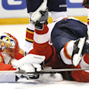 Florida Panthers goalie Roberto Luongo (1) stops a shot as defenseman Dmitry Kulikov, top, defends Detroit Red Wings center Joakim Andersson (18) in the second period during an NHL hockey game in Detroit Tuesday, Dec. 2, 2014 The Associated Press