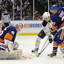New York Islanders goalie Anders Nilsson (45) and Brian Strait (37) defend against Buffalo Sabres' Matt D'Agostini (27) in the first period of an NHL hockey game on Saturday, March 15, 2014, in Uniondale, N.Y. The Islanders won 4-1 The Associated Press