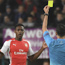 Referee Carlos Velasco Carballo of Spain shows the yellow card to Arsenal's Danny Welbeck during the Group D Champions League match between Anderlecht and Arsenal at Constant Vanden Stock Stadium in Brussels, Belgium, Wednesday Oct. 22, 2014
