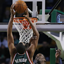 Milwaukee Bucks power forward John Henson (31) dunks the ball against Boston Celtics shooting guard Jeff Green in the first half of an NBA basketball game in Boston, Tuesday, Dec. 3, 2013 The Associated Press