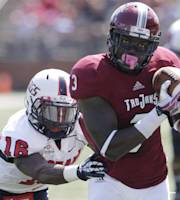 Troy wide receiver Eric Thomas (3) receives a 62-yard pass as South Alabama cornerback Montell Garner (16) pursues during the first half of an NCAA college football game in Troy, Ala., Saturday, Oct. 5, 2013. (AP Photo/Jay Sailors)