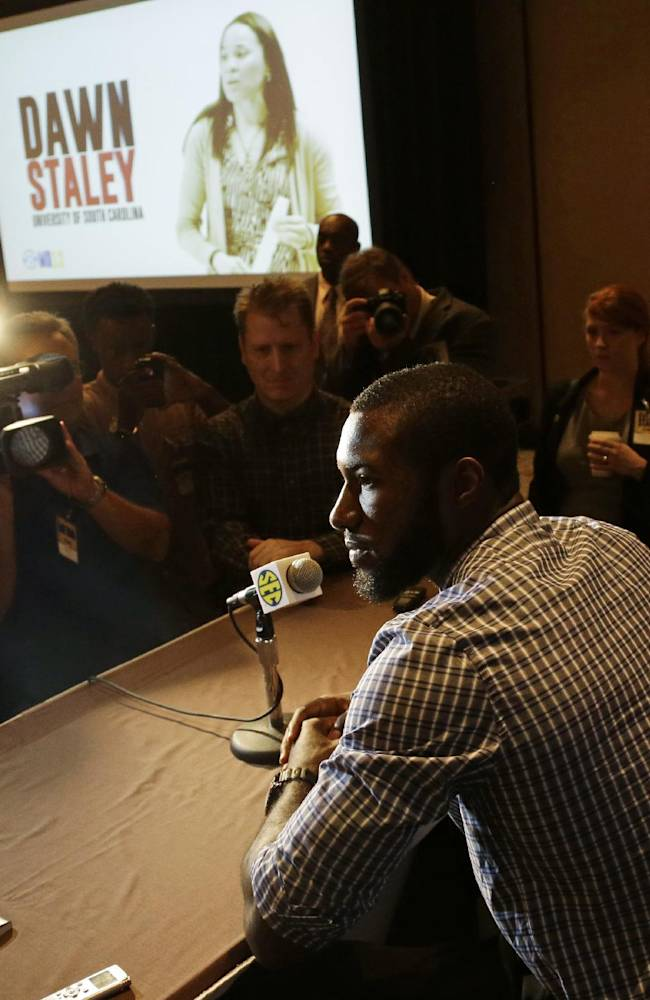 Florida player Patric Young talks with reporters during Southeastern Conference NCAA college basketball media day in Birmingham, Ala., Thursday, Oct. 17, 2013