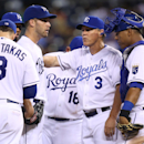 Kansas City Royals starting pitcher Danny Duffy, second from left, gets a pat on the chest from manager Ned Yost (3) as he in the taken out of a game against the Minnesota Twins in the seventh inning during a baseball Tuesday, Aug. 26, 2014, in Kansas City, Mo. (AP Photo/Ed Zurga)