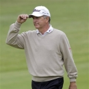 Jay Haas acknowledges the crowd as he walks to the 18th green during the first round of the Senior PGA Championship golf tournament at Bellerive Country Club, Thursday, May 23, 2013, in St. Louis. (AP Photo/Tom Gannam)