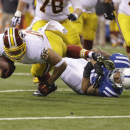 Washington Redskins tight end Jordan Reed, left, is stopped short of a first down by Indianapolis Colts inside linebacker Jerrell Freeman during the first half of an NFL football game Sunday, Nov. 30, 2014, in Indianapolis The Associated Press