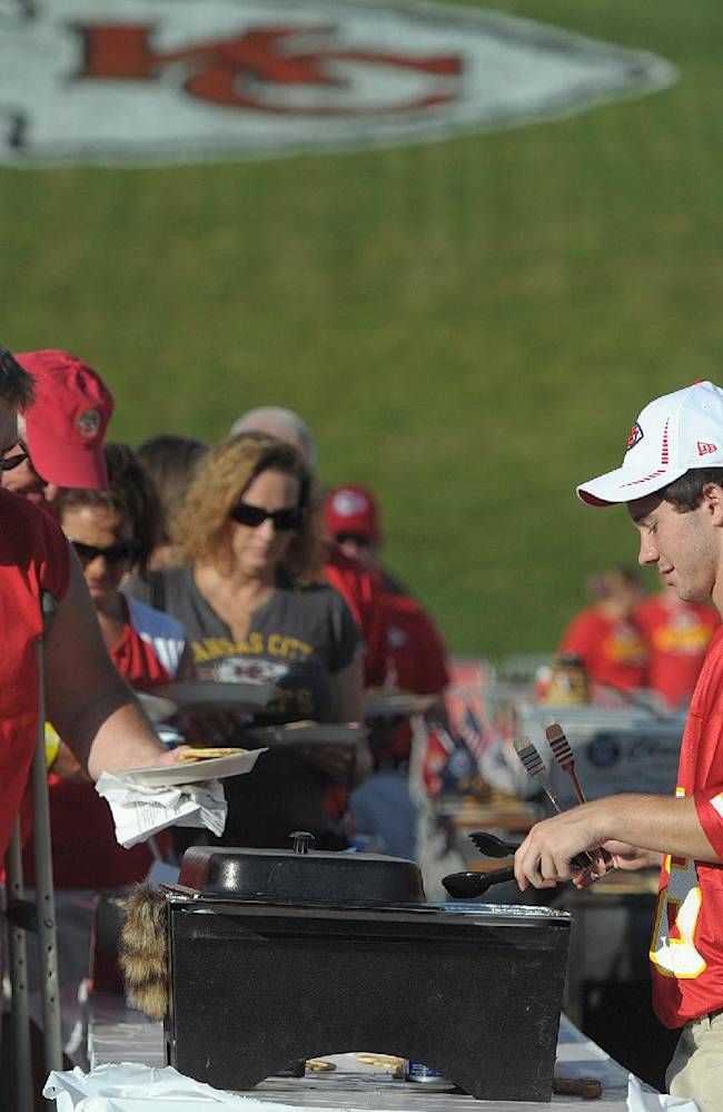 In this July 27, 2014, file photo, Kansas City Chiefs season-ticket holders line up for pancakes before the NFL football team's training camp in St. Joseph. Mo. By making fans feel as though they're part of the team, and offering gifts and experiences exclusive to members, the Chiefs have managed to expand their season ticket sales at a time when many franchises are having a hard time filling their stadiums