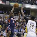 Atlanta Hawks' Louis Williams (3) shoot against Indiana Pacers' Ian Mahinmi during the first half in Game 2 of an opening-round NBA basketball playoff series Tuesday, April 22, 2014, in Indianapolis. (AP Photo/Darron Cummings)