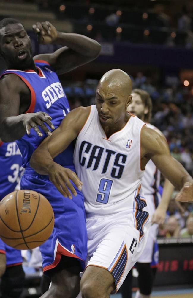 Philadelphia 76ers' Mac Koshwal, left, knocks the ball from Charlotte Bobcats' Gerald Henderson, right, during the first half of a preseason NBA basketball game in Charlotte, N.C., Thursday, Oct. 17, 2013