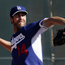 Los Angeles Dodgers' Dan Haren pitches during spring training baseball practice Sunday, Feb. 9, 2014, in Glendale, Ariz The Associated Press