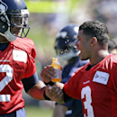 Seattle Seahawks quarterback Terrelle Pryor (2) teases fellow quarterback Russell Wilson by bumping his drink while walking past at an NFL football camp practice on Saturday, July 26, 2014, in Renton, Wash The Associated Press