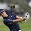Ryo Ishikawa of Japan, hits from the fourth fairway during the pro-am at the Honda Classic golf tournament in Palm Beach Gardens, Fla., Wednesday, Feb. 27, 2013. (AP Photo/Wilfredo Lee)