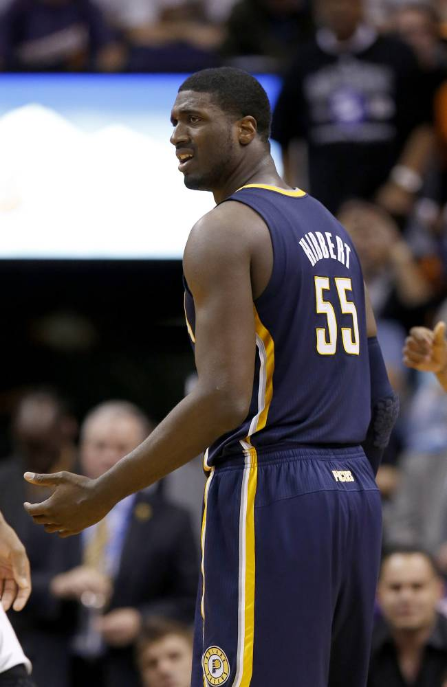 Indiana Pacers' Roy Hibbert looks confused after being called for a technical foul during the first half of an NBA basketball game against the Phoenix Suns Wednesday, Jan. 22, 2014, in Phoenix