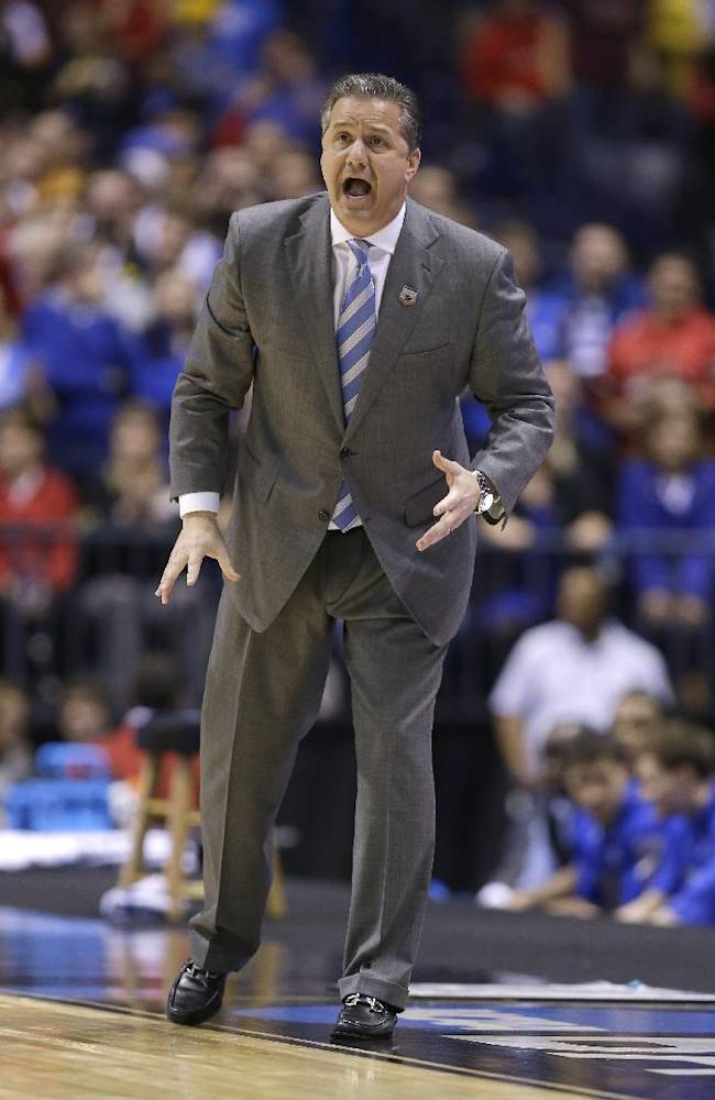 Kentucky head coach John Calipari yells during the first half of an NCAA Midwest Regional semifinal college basketball tournament game against the Louisville Friday, March 28, 2014, in Indianapolis