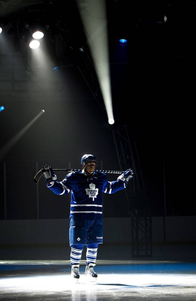 Toronto Maple Leafs NHL hockey forward Phil Kessel takes part in a video production on the opening day of  training camp in Toronto, Wednesday, Sept. 11, 2013