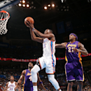 OKLAHOMA CITY, OK - December 7 : Kevin Durant #35 of the Oklahoma City Thunder goes up for the dunk against the Los Angeles Lakers during an NBA game on December 7, 2012 at the Chesapeake Energy Arena in Oklahoma City, Oklahoma. (Photo by Layne Murdoch/NBAE via Getty Images)
