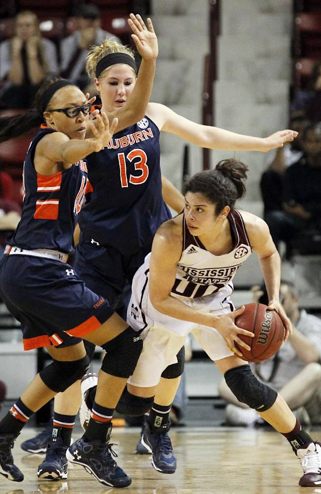 Mississippi State guard Dominique Dillingham (00) looks for an open player to pass to as Auburn guards Katie Frerking (13) and Brandy Montgomery, left, defend in the second half of an NCAA college basketball game at the WNIT in Starkville, Miss., Thursday, March 27, 2014. Mississippi State won 59-54