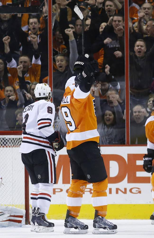 Philadelphia Flyers' Scott Hartnell (19) and Matt Read (24) celebrate after Hartnell's goal against Chicago Blackhawks' Antti Raanta (31), of Finland, and Nick Leddy (8) during the first period of an NHL hockey game, Tuesday, March 18, 2014, in Philadelphia