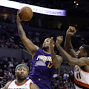 Phoenix Suns forward P.J. Tucker, middle, goes to the basket between Portland Trail Blazers' Thomas Robinson, right, and Mo Williams during the first half of an NBA basketball game in Portland, Ore., Friday, April 4, 2014 The Associated Press