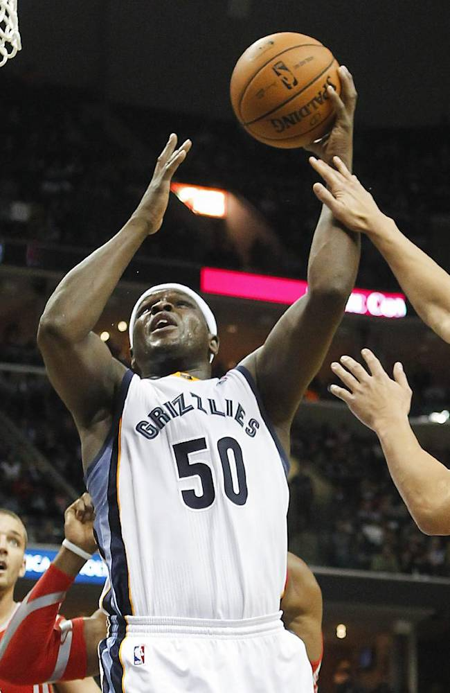 Memphis Grizzlies forward Zach Randolph (50) goes to the basket against Houston Rockets guard Jeremy Lin, right, in the second half of an NBA basketball game Saturday, Jan. 25, 2014, in Memphis, Tenn. The Grizzlies won 99-81