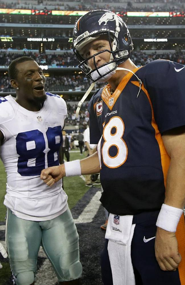 Dallas Cowboys wide receiver Dez Bryant (88) and Denver Broncos quarterback Peyton Manning (18) greet each other after an NFL football game Sunday, Oct. 6, 2013, in Arlington, Texas. The Broncos won 51-48