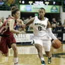Baylor's Odyssey Sims (0) drives the lane against Oklahoma's Morgan Hook, left, during the first half of an NCAAcollege basketball game Saturday, Jan. 26, 2013,. in Waco Texas. (AP Photo/LM Otero)