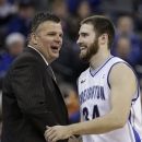 Creighton's Ethan Wragge (34), who scored 22 points in his team's 91-61 win against Drake, is congratulated by coach Greg McDermott, in the second half of an NCAA college basketball game in Omaha, Neb., Tuesday, Jan. 8, 2013. (AP Photo/Nati Harnik)