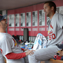 St. Louis Cardinals starting pitcher Adam Wainwright, right, talks with relief pitcher Joe Kelly after Wainwright was taken out after the seventh inning of a baseball game against the Cincinnati Reds, Monday, March 31, 2014, on opening day in Cincinnati.