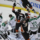 Anaheim Ducks' Matt Beleskey (39) and Corey Perry (10) celebrate a goal by Ryan Getzlaf in front of Dallas Stars goalie Kari Lehtonen (32), of Finland, during the first period in Game 1 of the first-round NHL hockey Stanley Cup playoff series on Wednesday