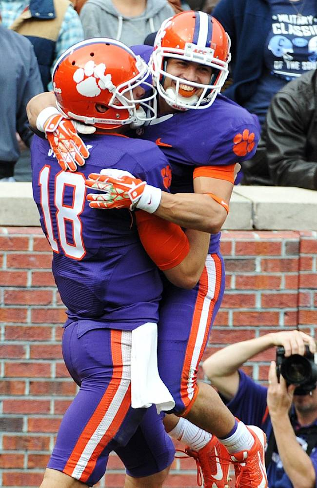 Clemson wide receiver Daniel Rodriguez (83) celebrates his touchdown with quarterback Cole Stoudt (18) during the second half of an NCAA college football game against The Citadel, Saturday, Nov. 23, 2013, in Clemson, S.C. Rodriguez, an Army veteran and Purple Heart recipient, is a walk-on player for Clemson