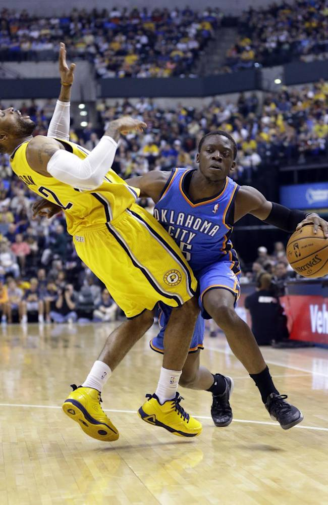 Indiana Pacers guard C.J. Watson, left, draws an offensive foul from Oklahoma City Thunder guard Reggie Jackson in the second half of an NBA basketball game in Indianapolis, Sunday, April 13, 2014