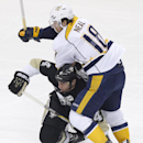 Pittsburgh Penguins' Rob Scuderi, bottom, upends Nashville Predators' James Neal (18) in the first period of an NHL hockey game, Sunday, Feb. 1, 2015 in Pittsburgh The Associated Press