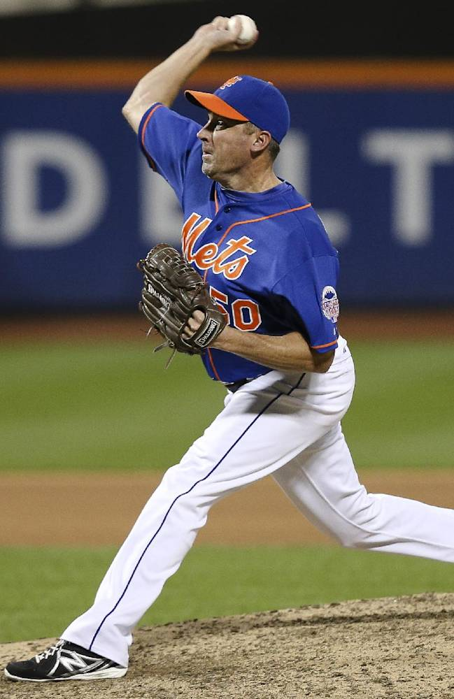 New York Mets relief pitcher Scott Atchison (50) throws in the tenth inning of a baseball game against the Milwaukee Brewers at Citi Field, Saturday, Sept. 28, 2013, in New York. The Brewers defeated the Mets, 4-2