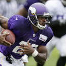 This July 27, 2014, file photo shows Minnesota Vikings running back Adrian Peterson running up field during NFL football training camp in Mankato, Minn. The NFL suspended Adrian Peterson without pay for at least the remainder of the season. The league sai