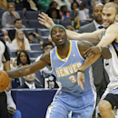 Denver Nuggets guard Ty Lawson (3) tries to get around Memphis Grizzlies guard Nick Calathes in the first half of an NBA basketball game Friday, April 4, 2014, in Memphis, Tenn The Associated Press