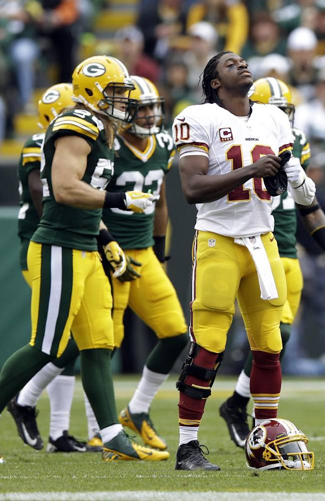 Washington Redskins quarterback Robert Griffin III reacts after being sacked during the first half of an NFL football game against the Green Bay Packers  Sunday, Sept. 15, 2013, in Green Bay, Wis