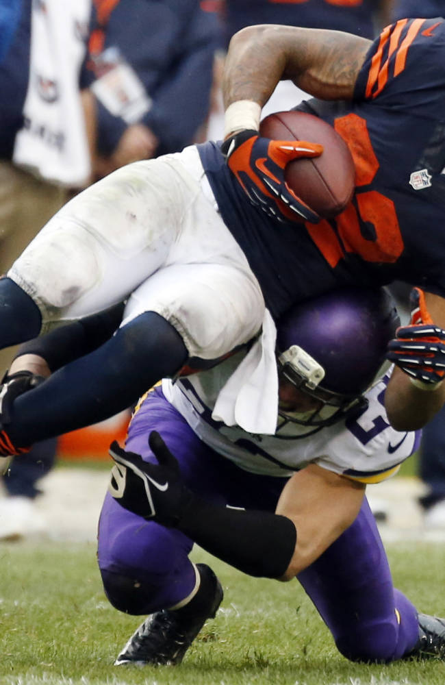 Chicago Bears running back Matt Forte, top, is tackled by Minnesota Vikings safety Harrison Smith during the second half of an NFL football game on Sunday, Sept. 15, 2013, in Chicago