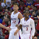 Los Angeles Clippers guard Chris Paul, right, reacts to a foul as forward Blake Griffin looks on during the second half in Game 1 of an opening-round NBA basketball playoff series against the Golden State Warriors, Saturday, April 19, 2014, in Los Angeles