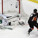Anaheim Ducks' Andrew Cogliano, right, scores against Dallas Stars goalie Kari Lehtonen, of Finland, during the third period in Game 2 of the first-round NHL hockey Stanley Cup playoff series on Friday, April 18, 2014, in Anaheim, Calif. The Ducks won 3-2