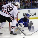 St. Louis Blues goalie Brian Elliott (1) deflects a shot from Chicago Blackhawks' Jimmy Hayes (39) in the first period of an
