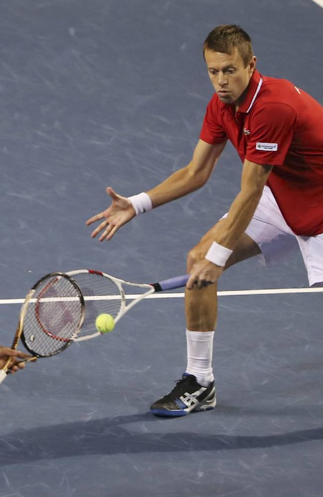Daniel Nestor, right, of Canada returns a ball as his doubles compatriot Frank Dancevic follows him during their 1st round of Davis Cup World Group doubles tennis match against Japan in Tokyo, Saturday, Feb. 1, 2014