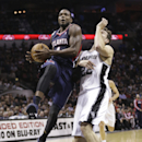 Atlanta Hawks' Paul Millsap, left, drives to the basket past San Antonio Spurs' Tiago Splitter (22), of Brazil, during the second half of an NBA basketball game, Monday, Dec. 2, 2013, in San Antonio The Associated Press