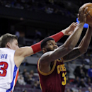 Cleveland Cavaliers forward Alonzo Gee, right, goes to the basket past Detroit Pistons forward Jonas Jerebko (33), of Sweden, during the second half of an NBA basketball game Wednesday, March 26, 2014, in Auburn Hills, Mich. The Cavaliers defeated the Pis