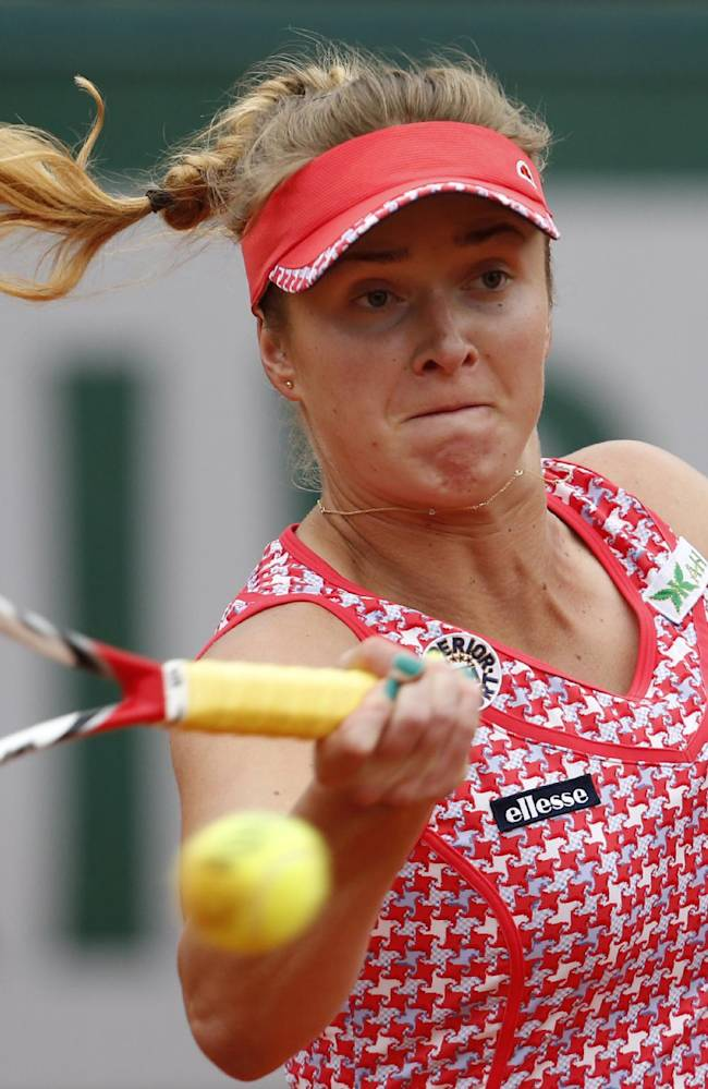 CORRECTING WINNER'S FIRST NAME TO ANA - Ukraine's Elina Svitolina returns the ball during the second round match of the French Open tennis tournament against Serbia's Ana Ivanovic at the Roland Garros stadium, in Paris, France, Thursday, May 29, 2014