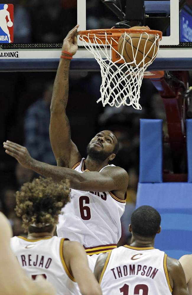 Cleveland Cavaliers' Earl Clark (6) dunks against the Minnesota Timberwolves in the first quarter of an NBA basketball game Monday, Nov. 4, 2013, in Cleveland