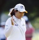 Inbee Park, of South Korea, acknowledges the crowd on the fourth green during the second round of the Marathon Classic golf tournament at Highland Meadows Golf Club in Sylvania, Ohio, Friday, July 19, 2013. (AP Photo/Rick Osentoski)